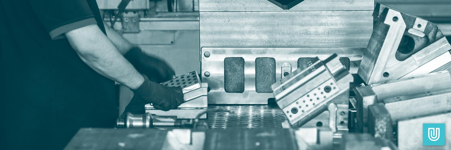 Unigloves nitrile gloves in use for metal fabrication.