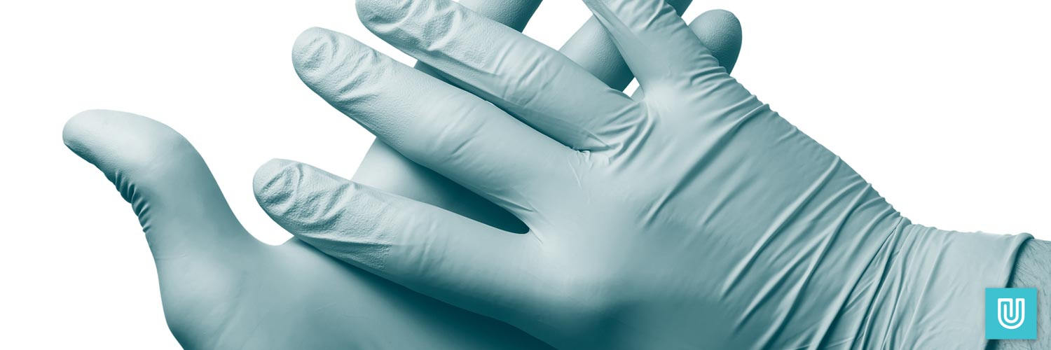 A pair of hybrid vinyl nitrile gloves being worn as PPE.