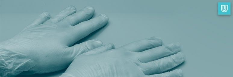 Unigloves vinyl gloves being worn by a worker as safety work gloves